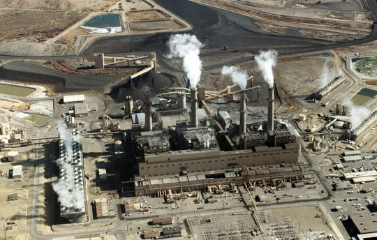 This Nov. 9, 2009, file photo shows the coal-fired San Juan Generating Station near Farmington. The Legislature will consider a complex bill that could reshape electricity production in New Mexico by phasing out a major coal-fired power plant and boosting state quotas for the production of renewable energy from sources such as wind and solar. The Democrat-sponsored bill was introduced to the New Mexico Legislature on Thursday, Feb. 7, 2019.