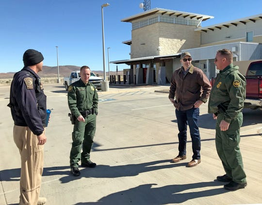 John Anderson, U.S. attorney for the New Mexico district, second from right, speaks with Border Patrol agents at the Antelope Wells port of entry on Thursday, Feb. 7.