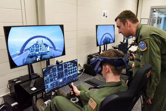 Lt. Col. Jason Turner, right, 80th Flying Training Wing director of Strategic Initiatives, helps Massachusetts Institute of Technology Reserve Officer Training Corps Cadet Ian Palmer guide a T-38C Talon through a mixed reality environment during a training session at Sheppard Air Force Base, Texas, Feb. 1, 2019. The 80th FTW has been installing and fine tuning virtual and mixed reality training platforms in their Innovation Lab, which allows Euro-NATO Joint Jet Pilot Training program students to further practice their skills outside of an actual aircraft.