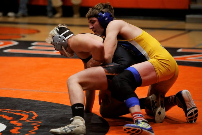 Bloomfield's Luke Whitley locks up Aztec's Hunter Medina in the 152-pound division match during Thursday's District 1-4A duals at Lillywhite Gym in Aztec. Whitley won via 6-5 decision.