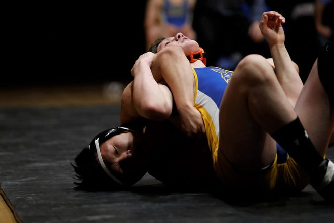 Aztec's Malcolm Altisi pulls back Bloomfield's Gerald Wiza by the right arm in the 170-pound division match during Thursday's District 1-4A duals at Lillywhite Gym in Aztec. Visit daily-times.com to see the latest sports photo galleries and video highlights.
