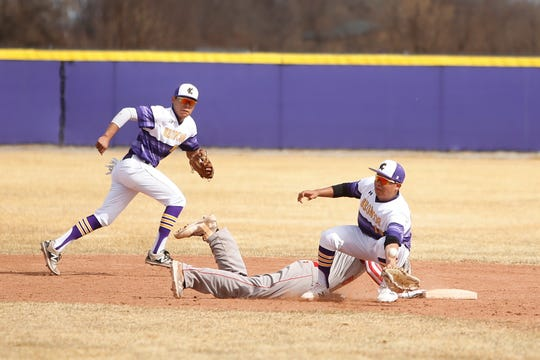 Kirtland Central's Dionte Yazzie (10) keeps the ball from flying past second base against Grants on Tuesday, March 13, 2018 at KCHS. The Broncos will open the 2019 season on March 7 at the Bloomfield Tournament.