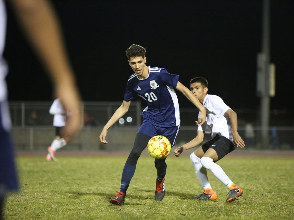 Desert Hot Springs' Josue Torres eyes the ball during the CIF round one playoff game against Palm Springs in Desert Hot Springs on Thursday, February 7, 2019. Desert Hot Springs won 3-2.