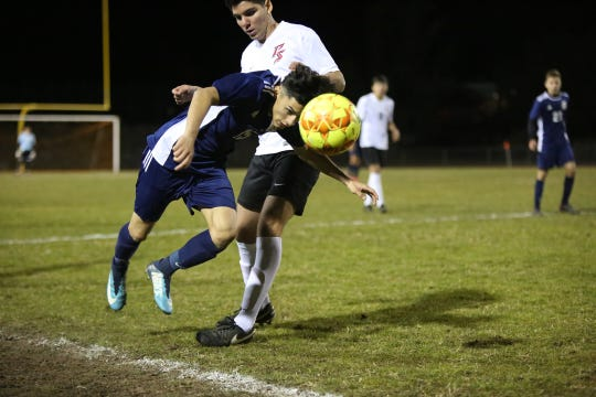 Desert Hot Springs' Michael Gutierrez heads the ball during the CIF round one playoff game against Palm Springs in Desert Hot Springs on Thursday, February 7, 2019. Desert Hot Springs won 3-2.