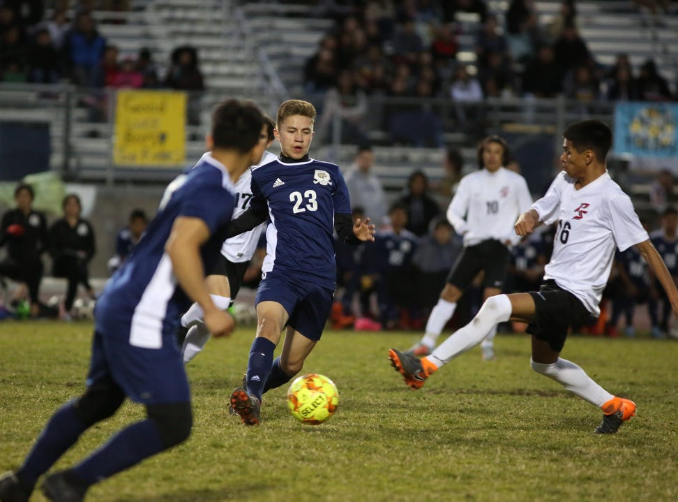 Desert Hot Springs' Leo Rochin passes the ball during the CIF round one playoff game against Palm Springs in Desert Hot Springs on Thursday, February 7, 2019. Desert Hot Springs won 3-2.