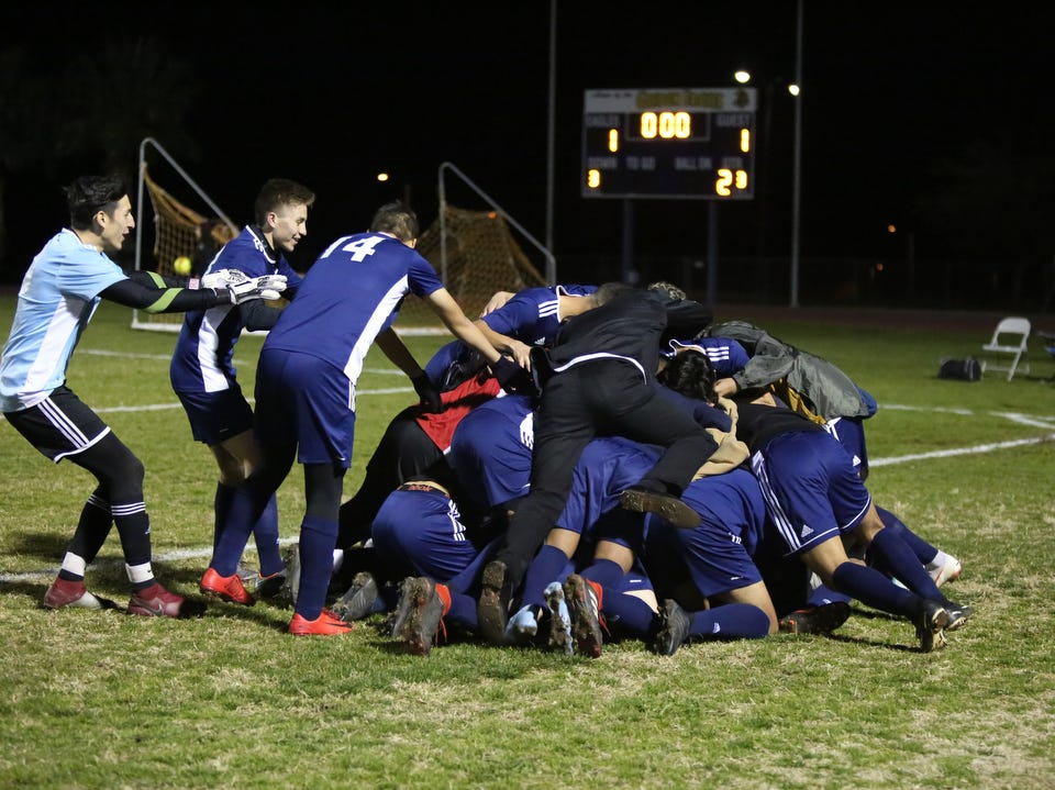Desert Hot Springs' teammates celebrate their first goal during the CIF round one playoff game against Palm Springs in Desert Hot Springs on Thursday, February 7, 2019. Desert Hot Springs won 3-2.