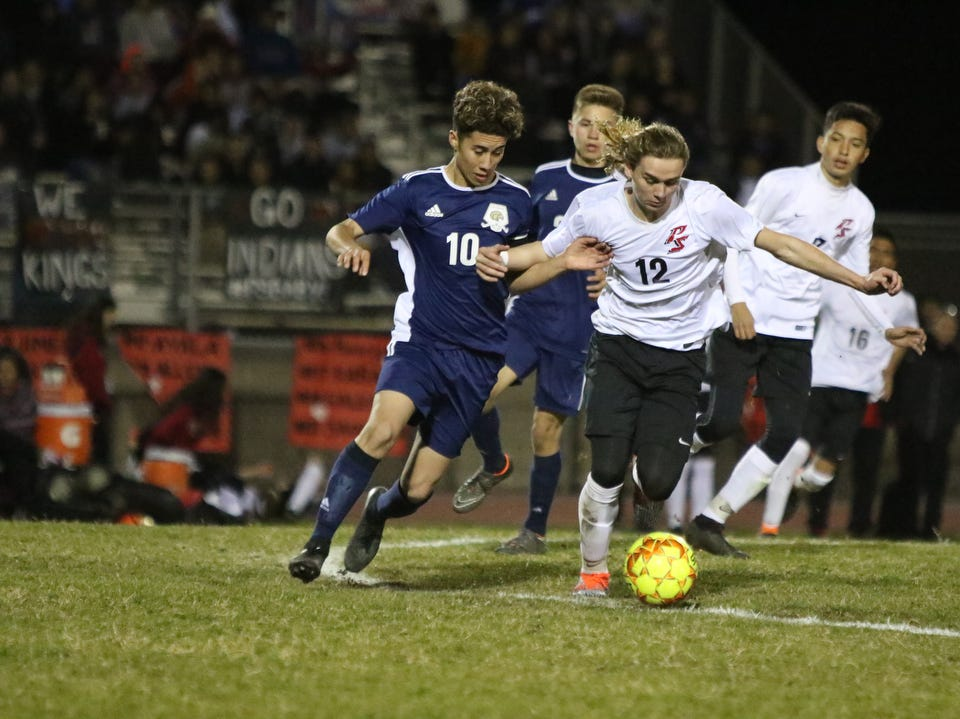 Desert Hot Springs' Gilbert Regalado, left, and Palm Springs' Brayden Allenbeck battle for the ball during the CIF round one playoff game against in Desert Hot Springs on Thursday, February 7, 2019. Desert Hot Springs won 3-2.