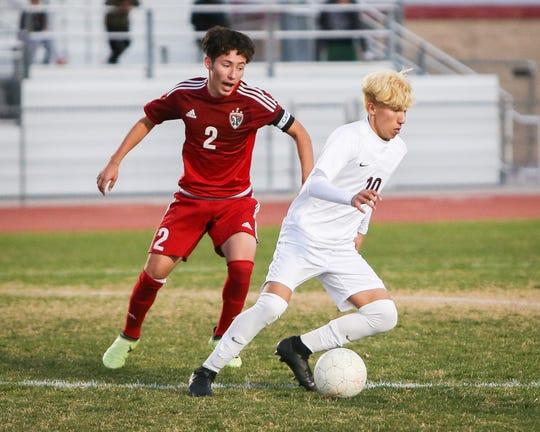 Damian Vasquez steals the ball from Desert Mirage's Errick Serrano.