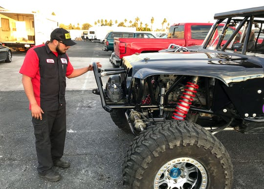 """Arturo """"Art"""" Soria inspects his car at A-OK Auto in Indio days before racing in the Every Man Challenge at the 2019 King of the Hammers."""