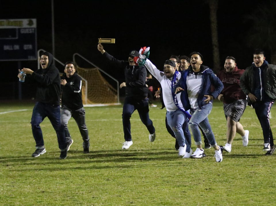 Desert Hot Springs' fans rush the field to congratulate the team after their CIF round one playoff game against Palm Springs in Desert Hot Springs on Thursday, February 7, 2019. Desert Hot Springs won 3-2.