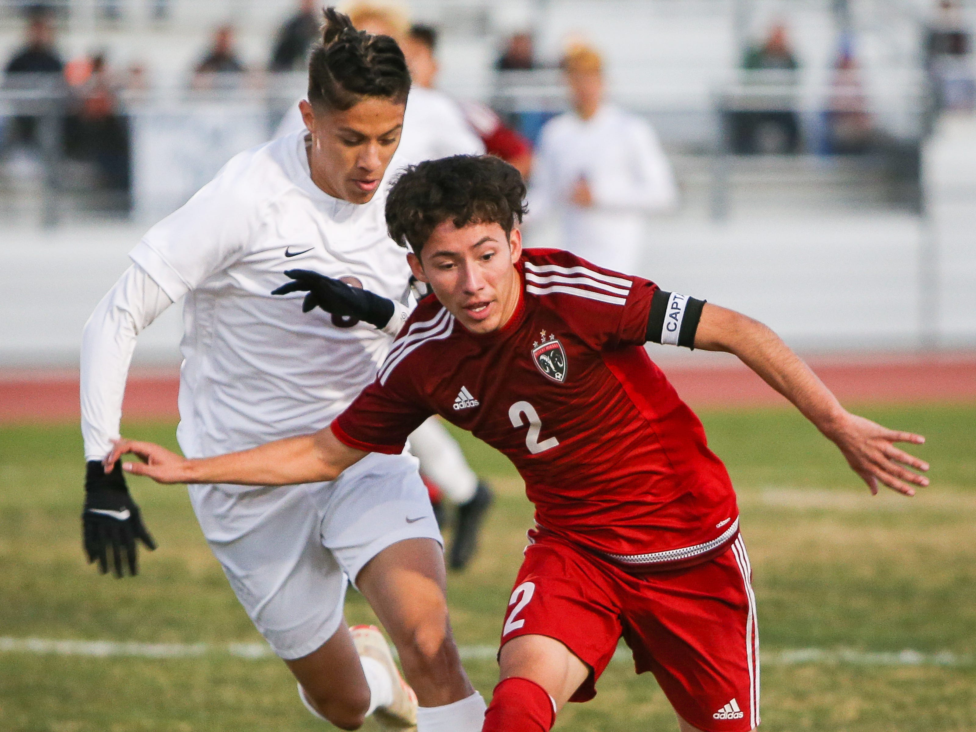 Desert Mirage's Erick Serrano steals the ball from La Quinta's Cesar Rodriguez.