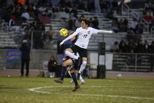 Palm Springs' Santiago Karam controls the ball during the CIF round one playoff game against Desert Hot Springs on Thursday, February 7, 2019. Desert Hot Springs won 3-2.