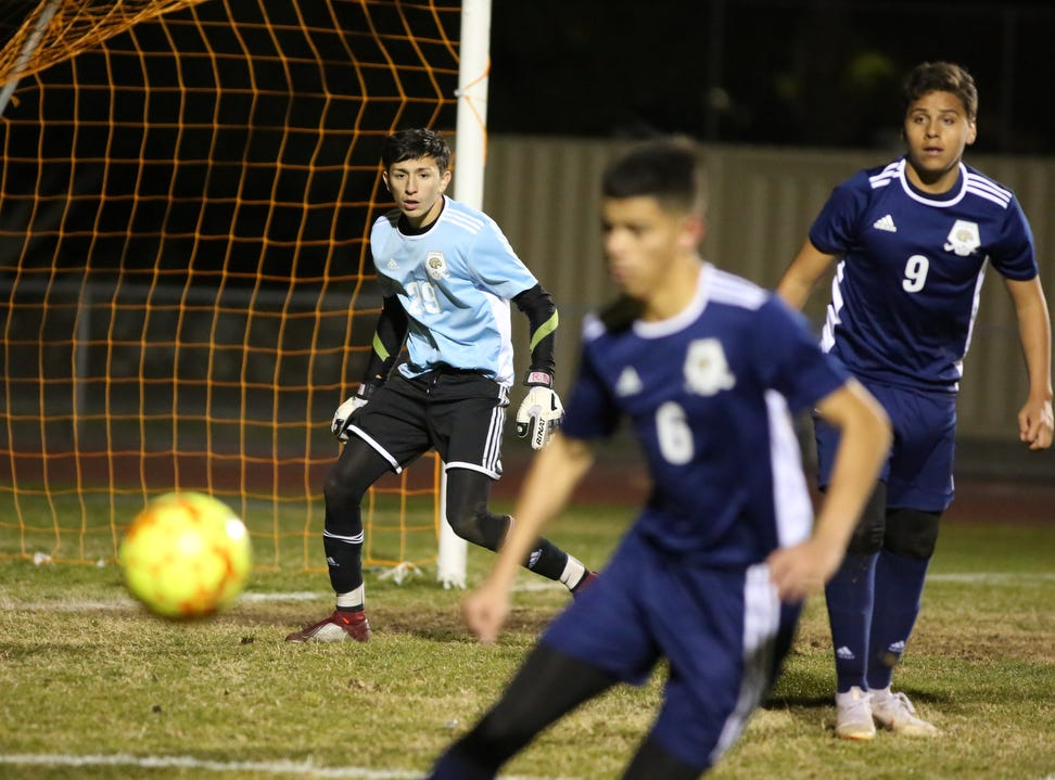 Desert Hot Springs' goal keeperJohnny Gutierrez keeps his eye on the ball during the CIF round one playoff game against Palm Springs in Desert Hot Springs on Thursday, February 7, 2019. Desert Hot Springs won 3-2.