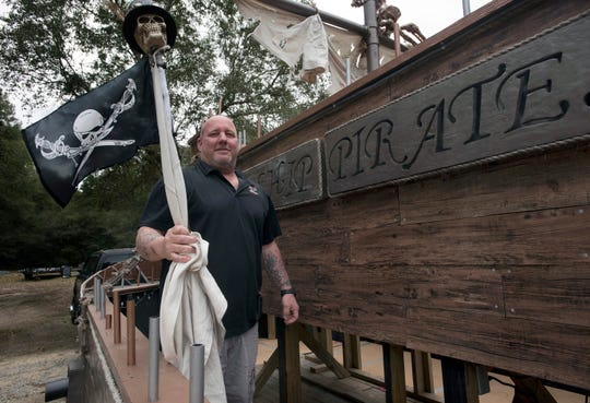 Patrick Fitzgerald, president of the Krewe of Airship Pirates, gets the krewe's float ready Friday for the upcoming Mardi Gras parade in Milton. The parade begins at 6 p.m. Saturday, Feb. 16, outside the Guy Thompson Community Center.