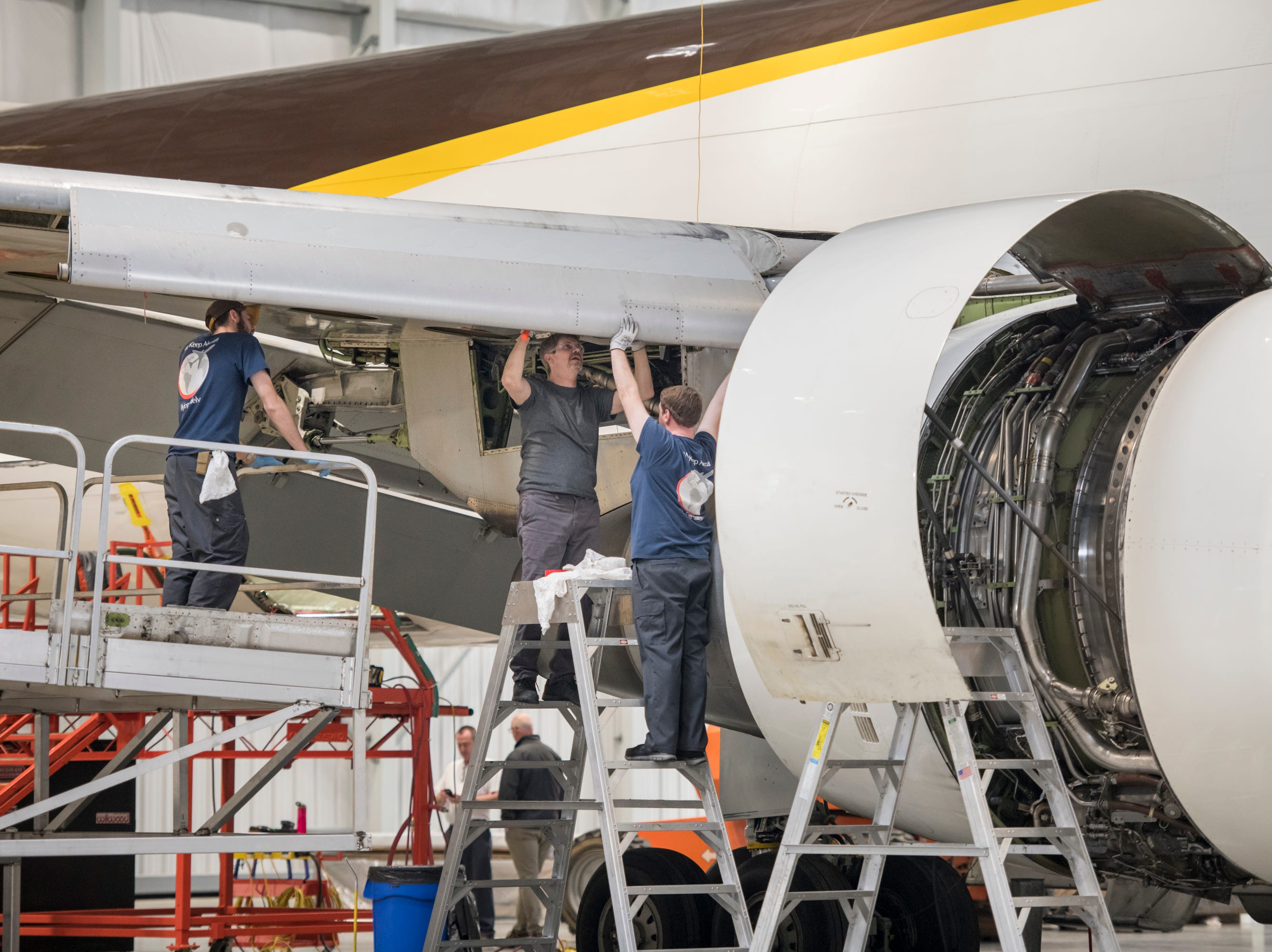 Mechanics work on an airplane at ST Engineering at the Pensacola International Airport in Pensacola on Friday, February 8, 2019.