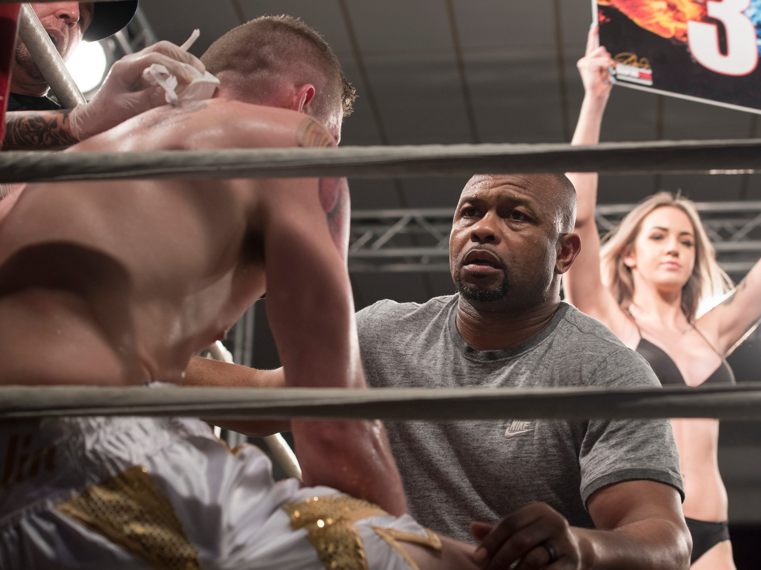 Roy Jones Jr., right, coaches his boxer during the Island Fights 52 at the Jadji Shrine in Pensacola on Thursday, February 7, 2019.