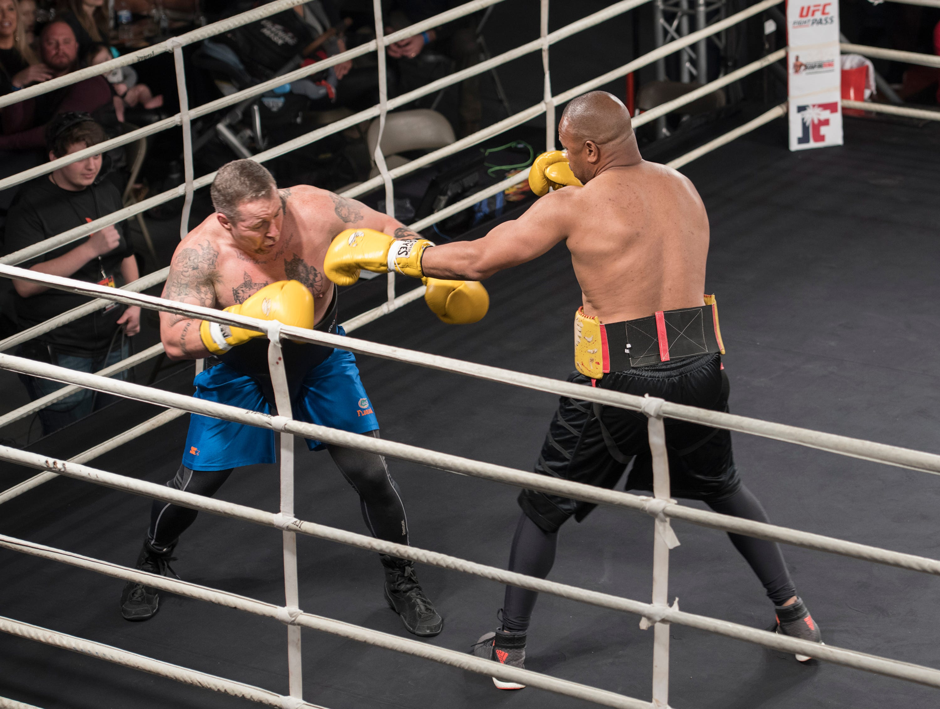 Roy Jones Jr., right, fights against Dion Rizzuto in an exhibition match during the Island Fights 52 at the Jadji Shrine in Pensacola on Thursday, February 7, 2019.