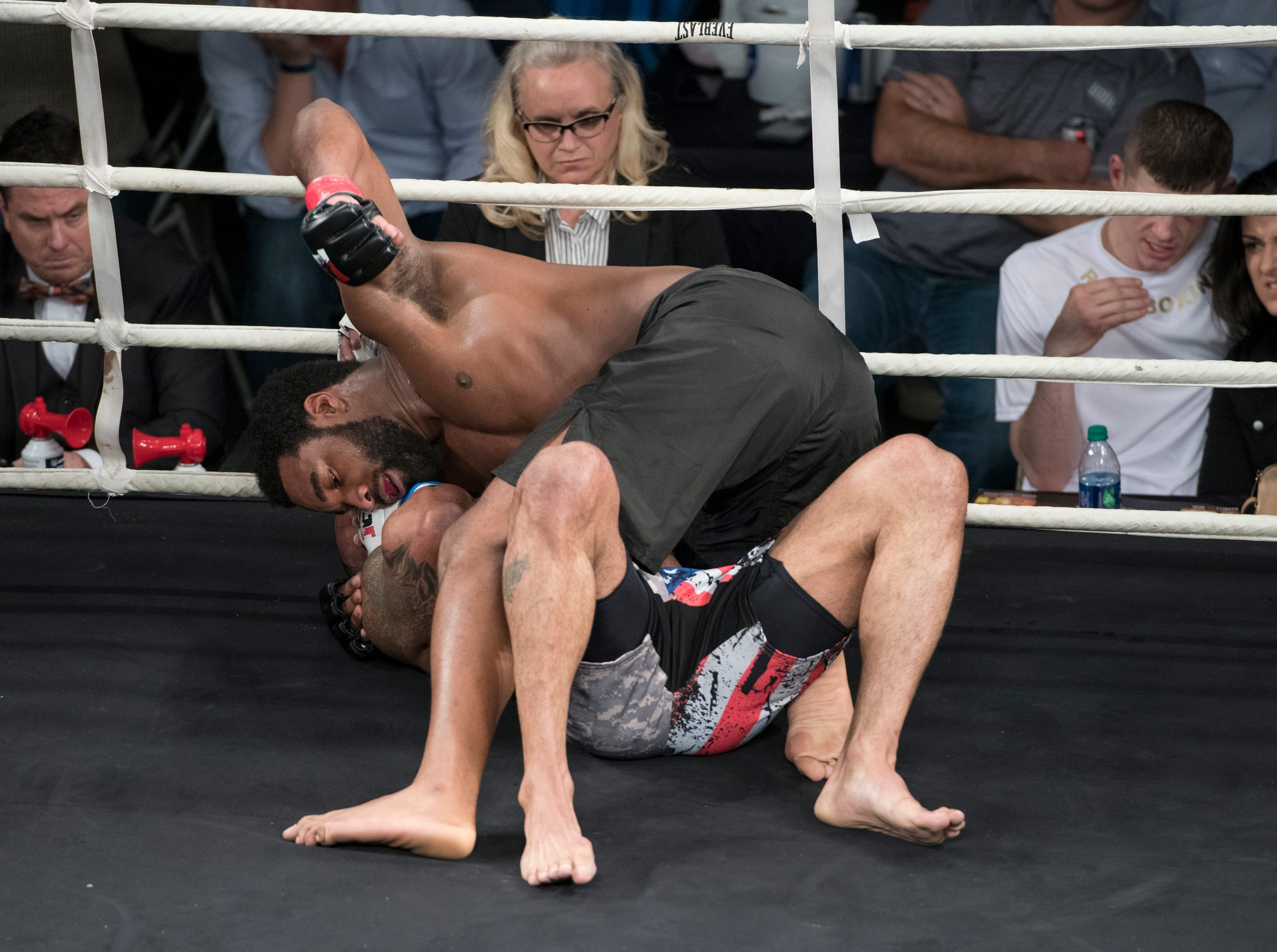Andre Hall (red taped gloves) and Michael Morgan (blue taped gloves) fight during the Island Fights 52 at the Jadji Shrine in Pensacola on Thursday, February 7, 2019.