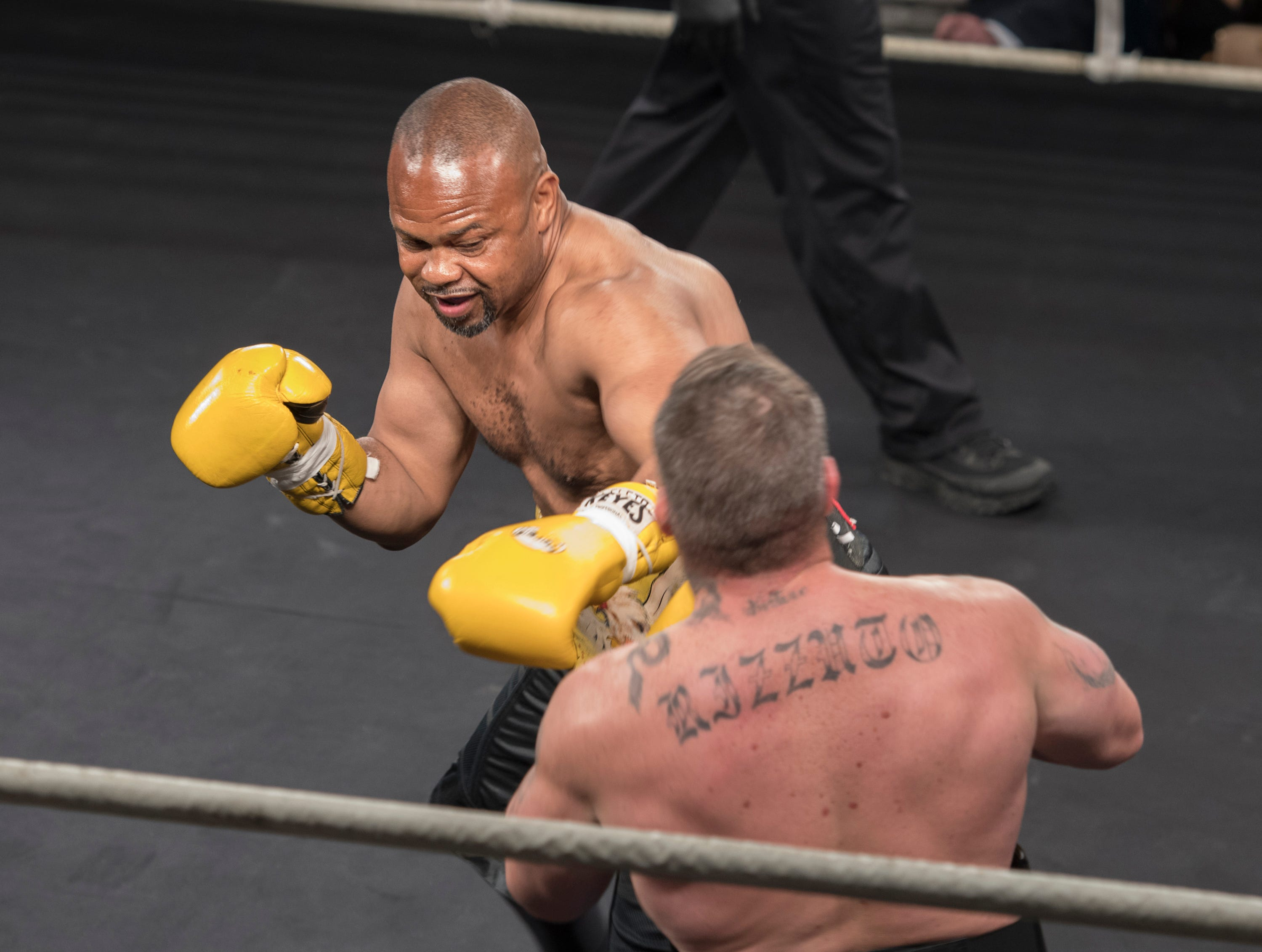 Roy Jones Jr., left, fights against Dion Rizzuto in an exhibition match during the Island Fights 52 at the Jadji Shrine in Pensacola on Thursday, February 7, 2019.