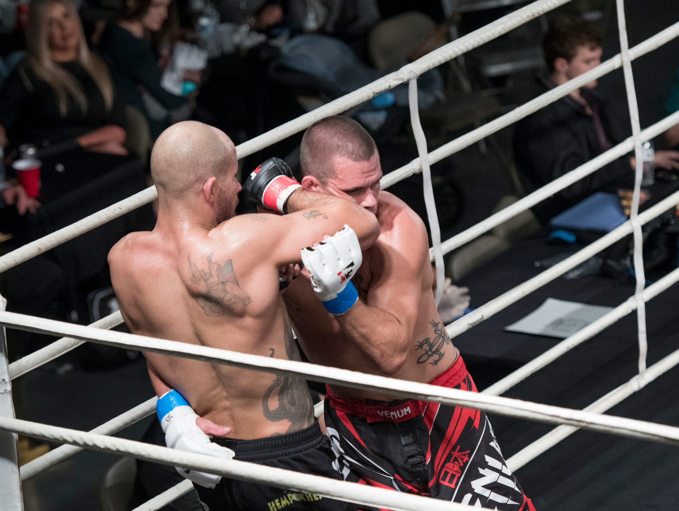 Robert Turnquest (red taped gloves) and Wesley Golden (blue taped gloves) fight during the Island Fights 52 at the Jadji Shrine in Pensacola on Thursday, February 7, 2019.