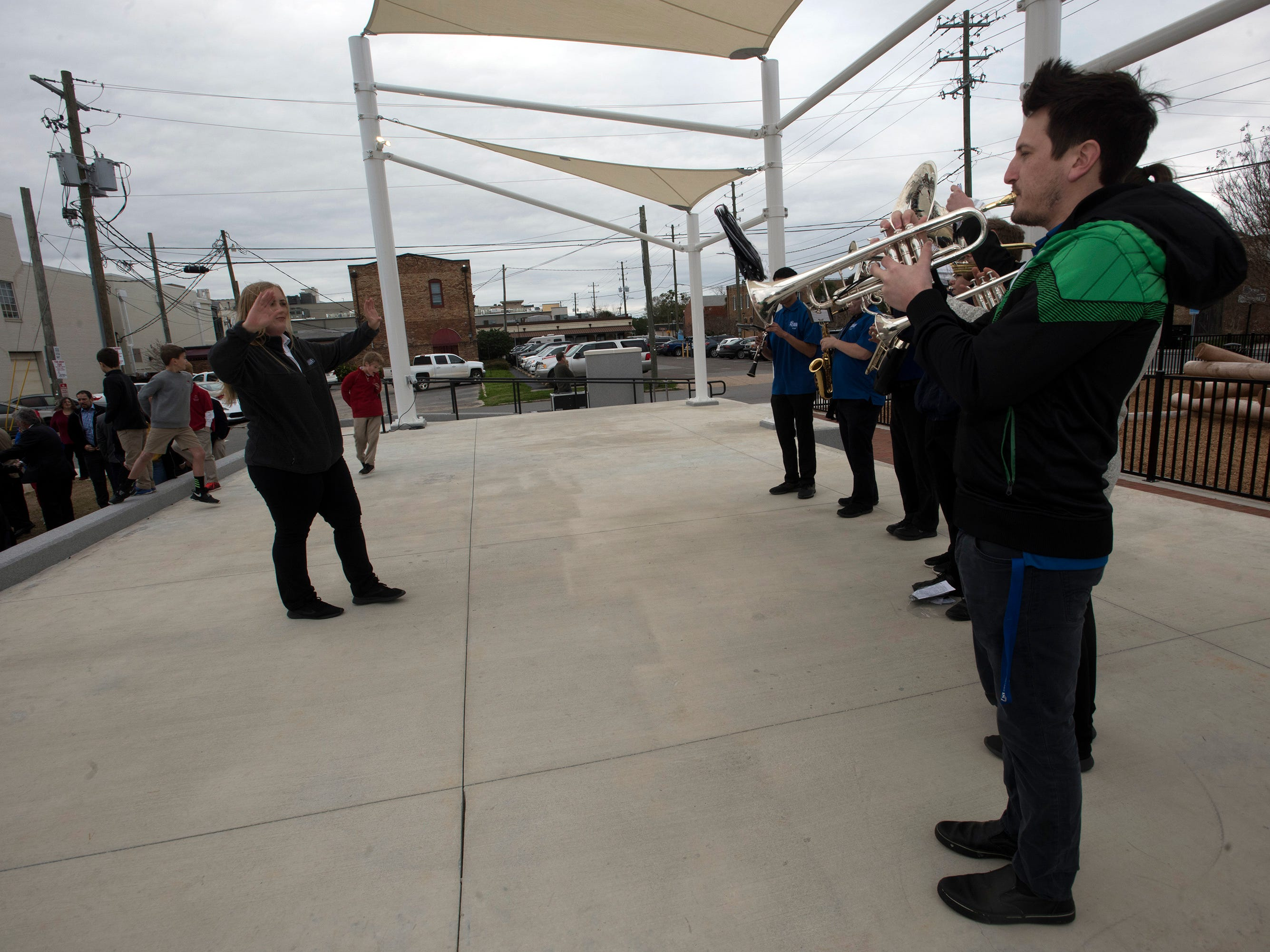 Members of the University of West Florida Athletic Band provide the music at the dedication for UWF's new Museum Plaza on Friday, Feb 8, 2019.   The new downtown park is behind  The T. T. Wentworth Jr. Florida State Museum