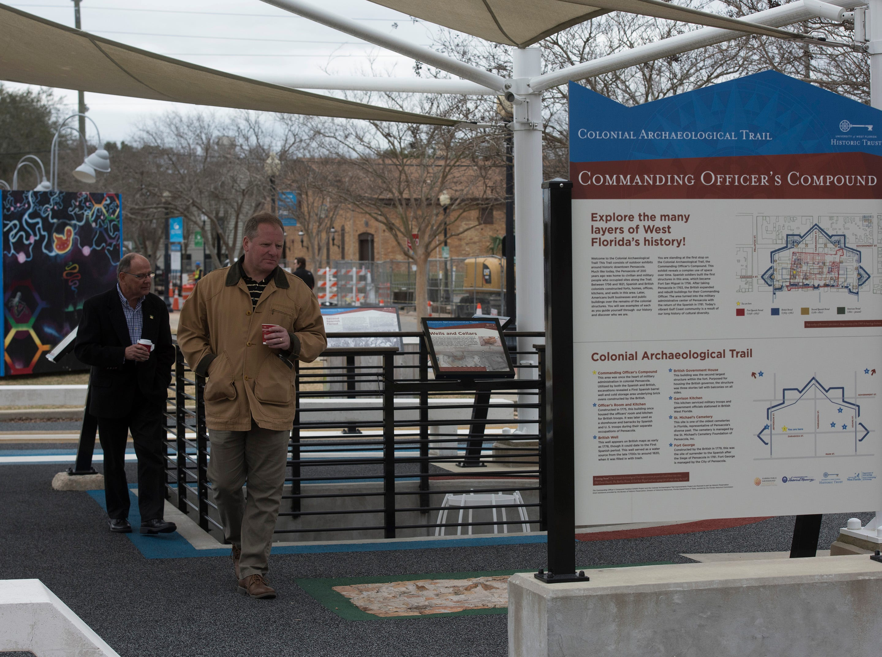 Visitors explore the offering at the new Museum Plaza behind The T. T. Wentworth Jr. Florida State Museum in downtown Pensacola on Friday, Feb. 8, 2019. The University of West Florida officially dedicated the new park space during a ceremony on Friday.