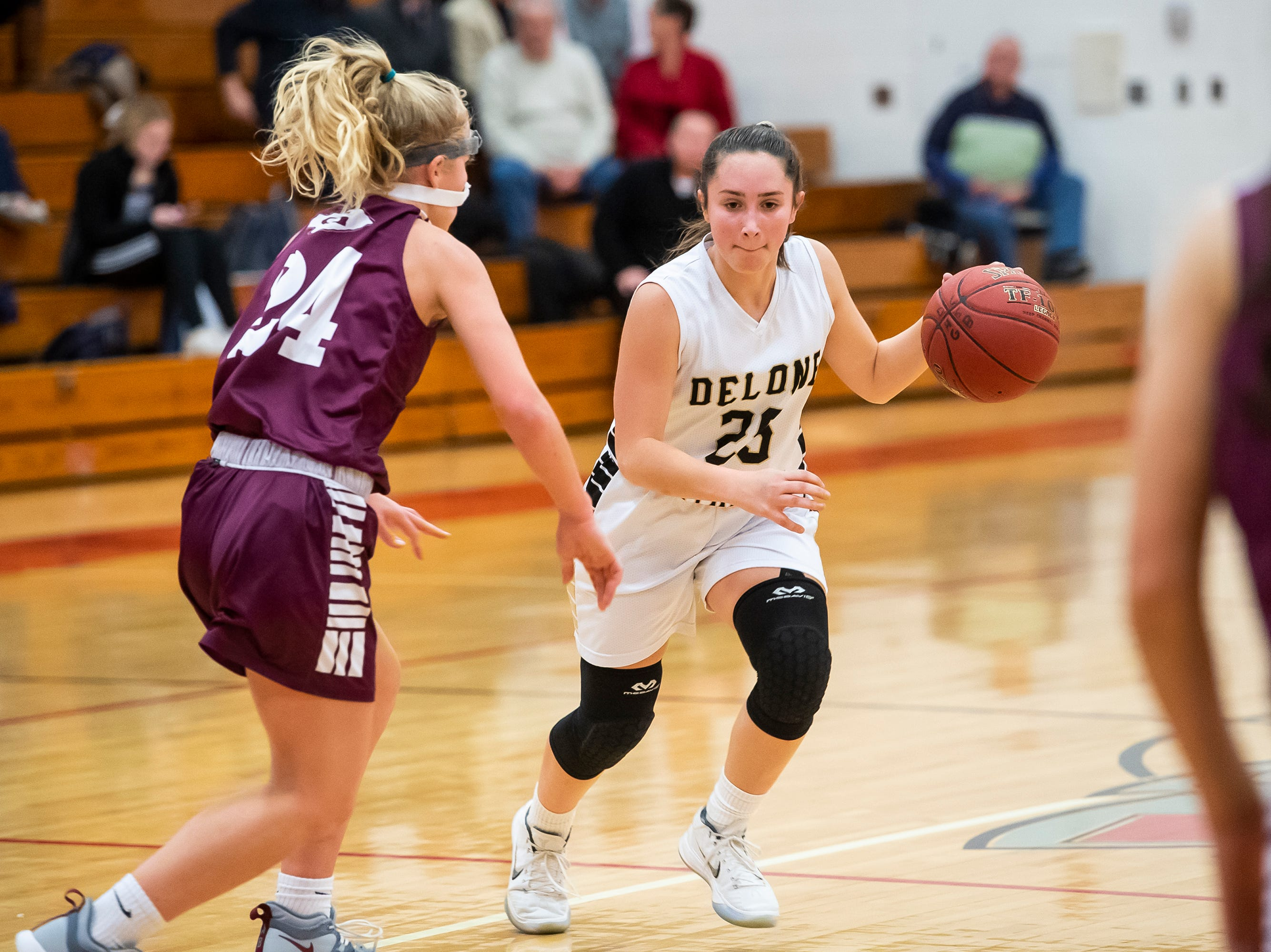 Delone Catholic's Camryn Felix dribbles down the court as Gettysburg's Anne Bair defends during play in a YAIAA quarterfinal game at Dover High School Friday, February 8, 2019.