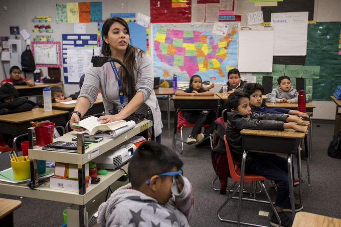 Erica Kurz teaches a 3rd grade class on Thursday, Feb. 7, 2019, at Longfellow Elementary in Mesa, Ariz. A new bill going through the legislature would change how much mandated instruction time ELL students receive, and would curb unintended consequences like segregated recess and lunch periods.