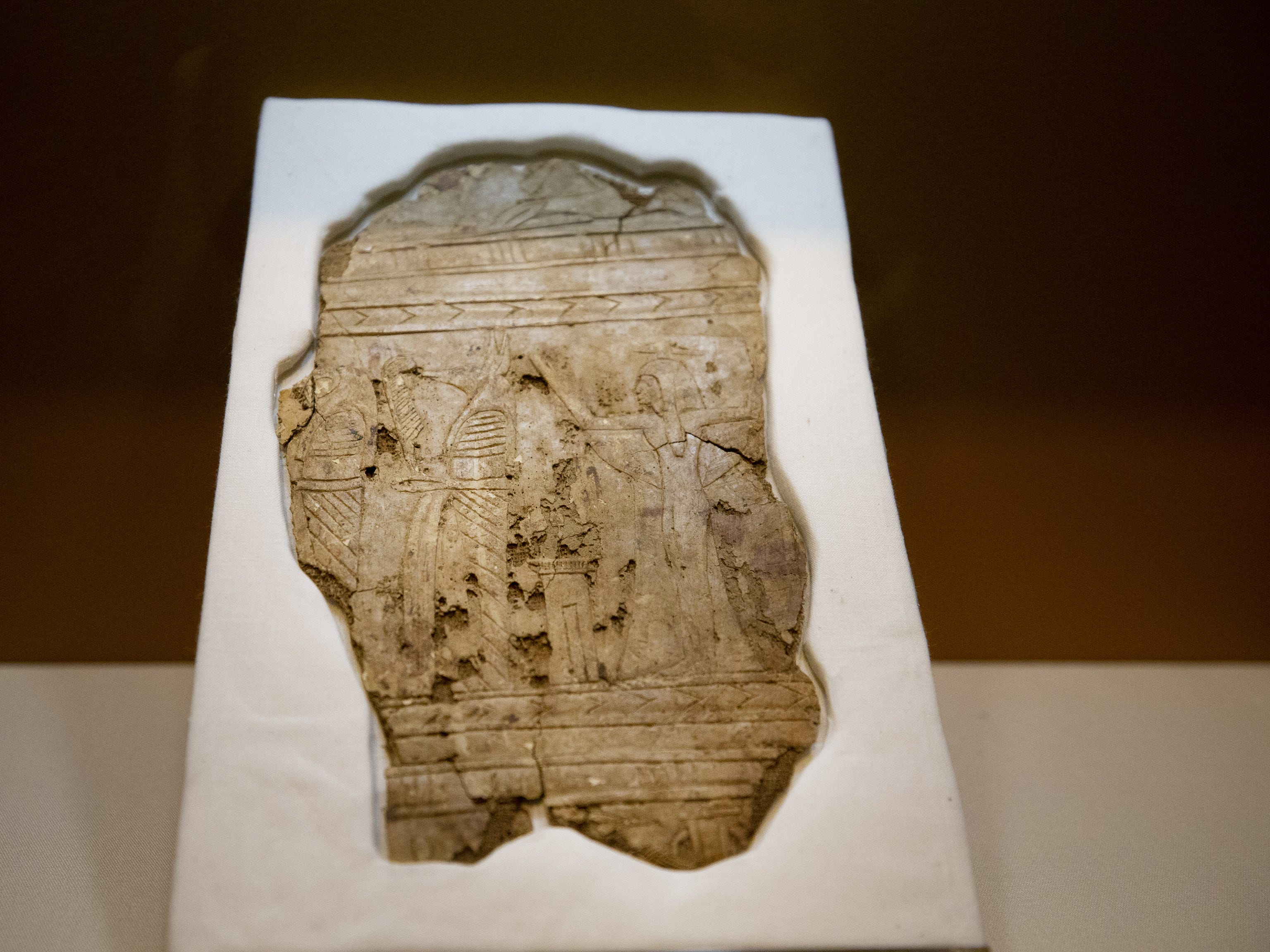 Mummies of the World: The Exhibition displays a fragment of mummy cloth. The exhibit at the Arizona Science Center includes mummies from Egypt, Europe and the U.S.