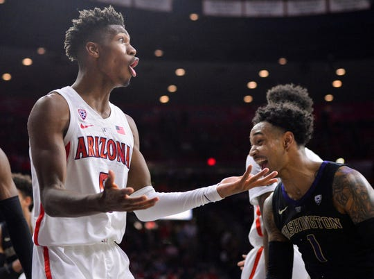 Arizona Wildcats guard Brandon Randolph (5) reacts to a call as Washington Huskies guard David Crisp (1) celebrates during the second half at McKale Center.
