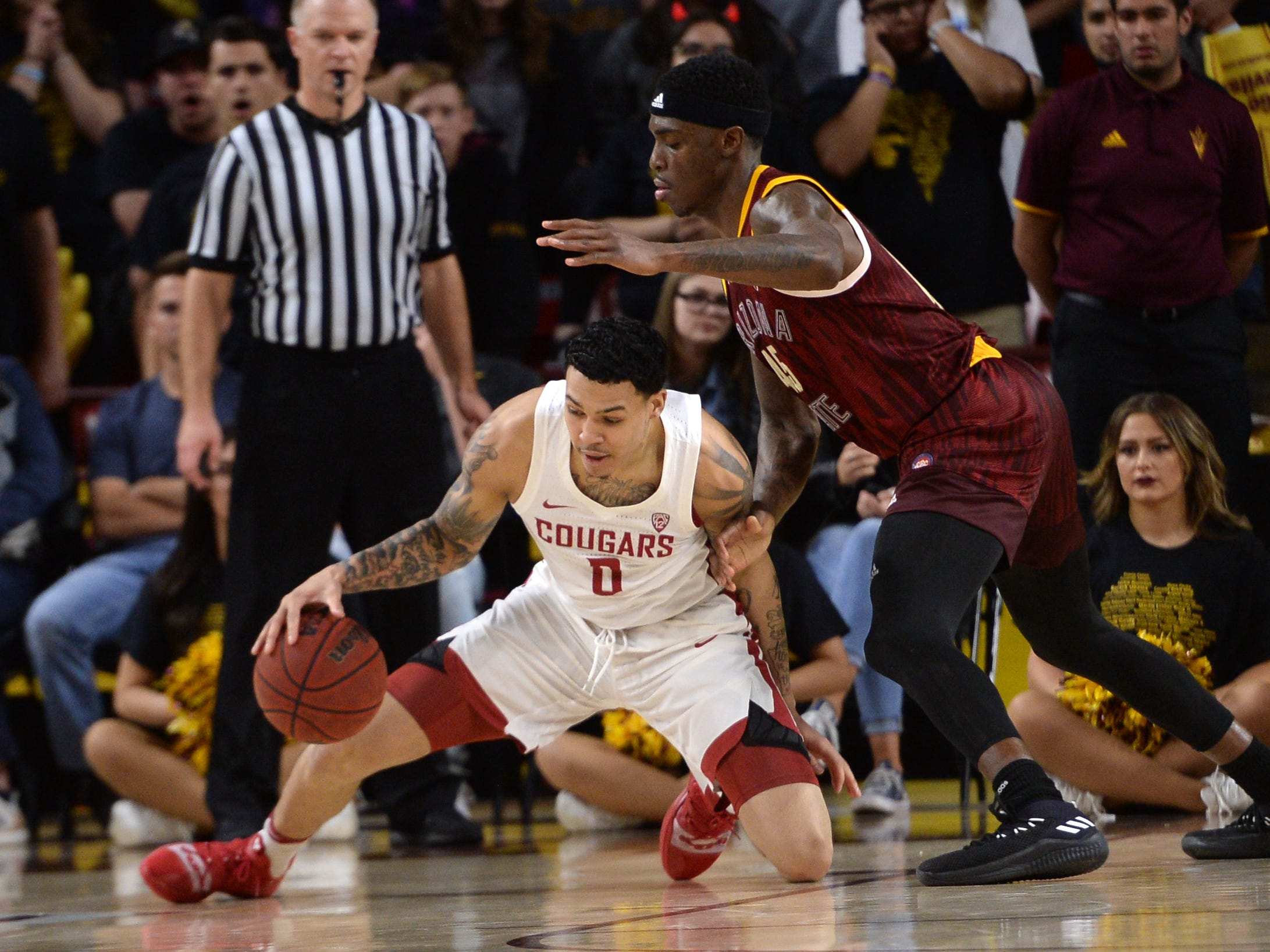 Feb 7, 2019; Tempe, AZ, USA; Washington State Cougars forward Isaiah Wade (0) protects the ball from Arizona State Sun Devils forward Zylan Cheatham (45) during the second half at Wells Fargo Arena (AZ).