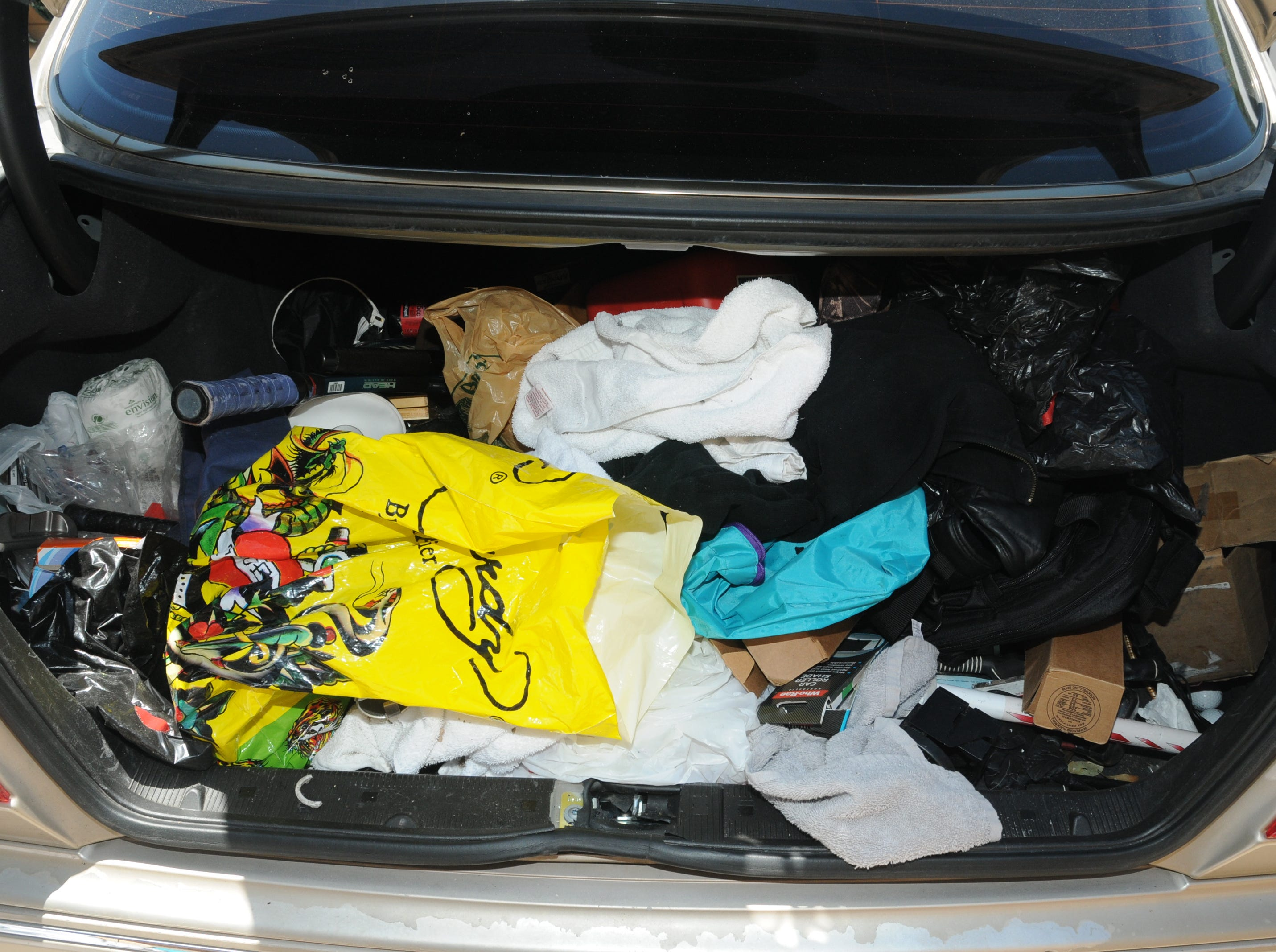 Scottsdale Police Department photo showing the contents inside the trunk of Dwight Lamon Jones' car.  After a bitter divorce and failed years-long custody battle for his son, Jones went on a four-day shooting spree from May 31 to June 3, 2018, that left six people dead, before taking his own life.
