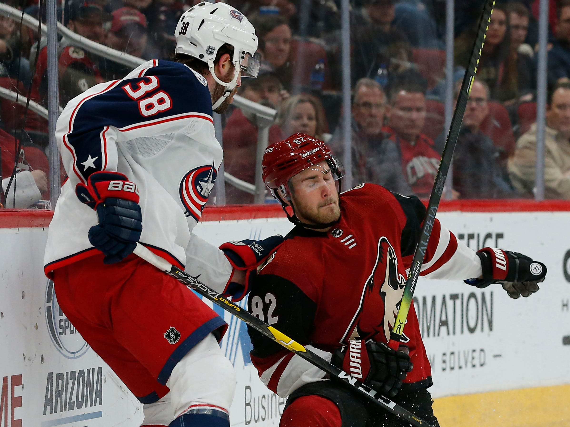 Columbus Blue Jackets center Boone Jenner (38) in the first period during an NHL hockey game against Arizona Coyotes defenseman Jordan Oesterle (82), Thursday, Feb. 7, 2019, in Glendale, Ariz.