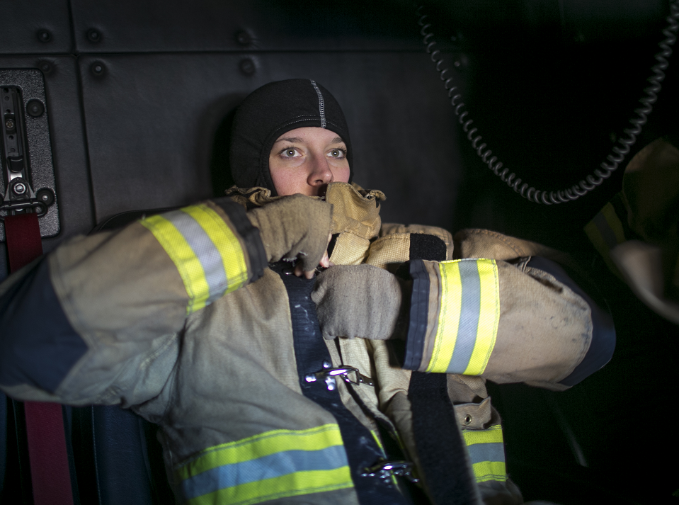 Firefighter Leigh Graziano suits up on a call with Glendale Fire Department 154 on Feb. 7, 2019, in Glendale. The city of Phoenix and the city of Glendale began operating out of Department 154 after a successful pilot program.
