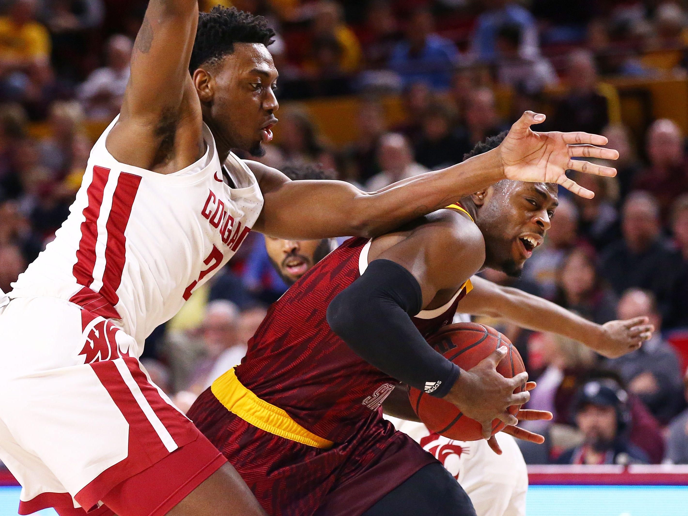 Arizona State Sun Devils guard Luguentz Dort is pressured by Washington State Cougars forward Robert Franks (3) in the first half on Feb. 7 at Wells Fargo Arena in Tempe.