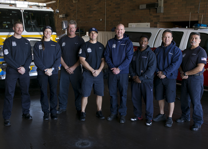 Firefighters with Glendale Fire Department 154 stand in the fire-truck bay at their station on Feb. 7, 2019, in Glendale. The city of Phoenix and the city of Glendale began operating out of Department 154 after a successful pilot program.