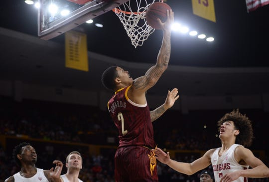 Rob Edwards puts up a layup against the Washington State Cougars during a game at Wells Fargo Arena.