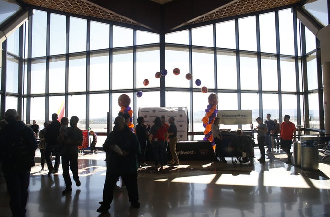"Passengers make their way to their flights in terminal 4 during a Suns and Southwest ""trading places"" event where players took on the roles of Southwest Airlines employees at Phoenix Sky Harbor Airport in Phoenix, Ariz. on February 7, 2019."