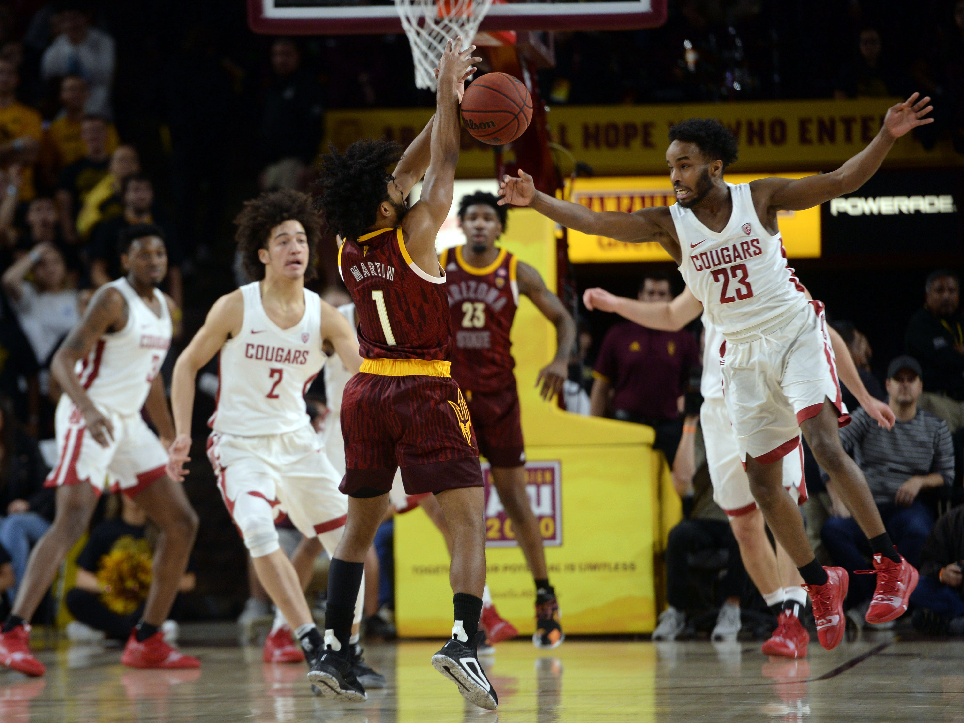 Feb 7, 2019; Tempe, AZ, USA; Washington State Cougars guard Ahmed Ali (23) pokes the ball away from Arizona State Sun Devils guard Remy Martin (1) during the first half at Wells Fargo Arena (AZ).