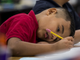 Cristian Diaz, 2nd grade, writes during class on Thursday, Feb. 7, 2019, at Longfellow Elementary in Mesa, Ariz. A new bill going through the legislature would change how much mandated instruction time ELL students receive, and would curb unintended consequences like segregated recess and lunch periods.