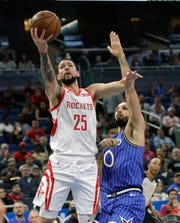 Houston Rockets guard Austin Rivers (25) goes up to shoot against Orlando Magic's Evan Fournier, right, during the first half of an NBA basketball game, Sunday, Jan. 13, 2019, in Orlando, Fla. (AP Photo/John Raoux)