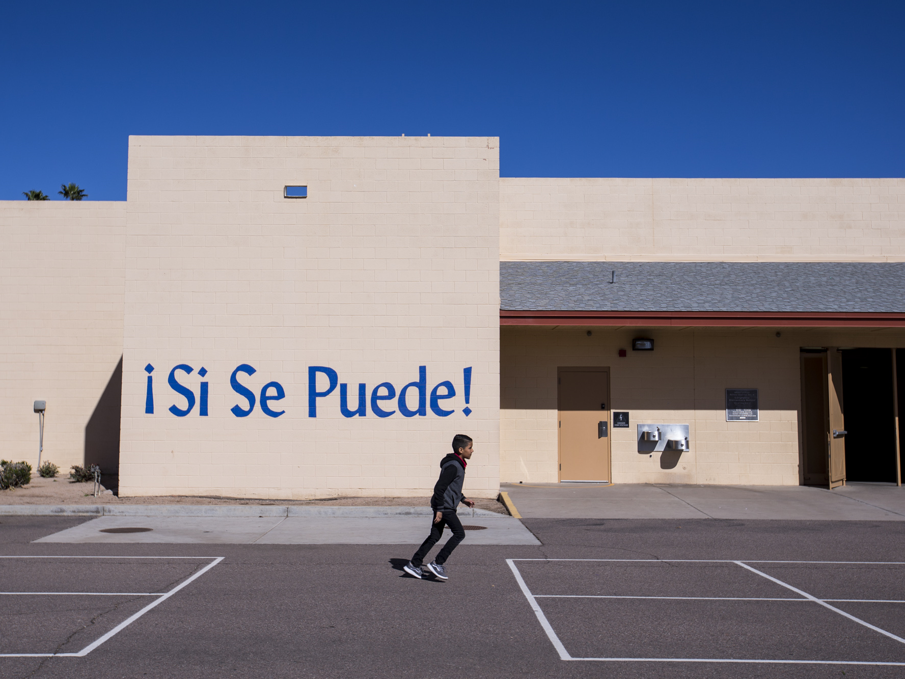 A student runs outside on Thursday, Feb. 7, 2019, at Longfellow Elementary in Mesa, Ariz. A new bill going through the legislature would change how much mandated instruction time ELL students receive, and would curb unintended consequences like segregated recess and lunch periods.