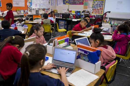 Second grade students work in Robin Watson's class on Thursday, Feb. 7, 2019, at Longfellow Elementary in Mesa, Ariz. A new bill going through the legislature would change how much mandated instruction time ELL students receive, and would curb unintended consequences like segregated recess and lunch periods.