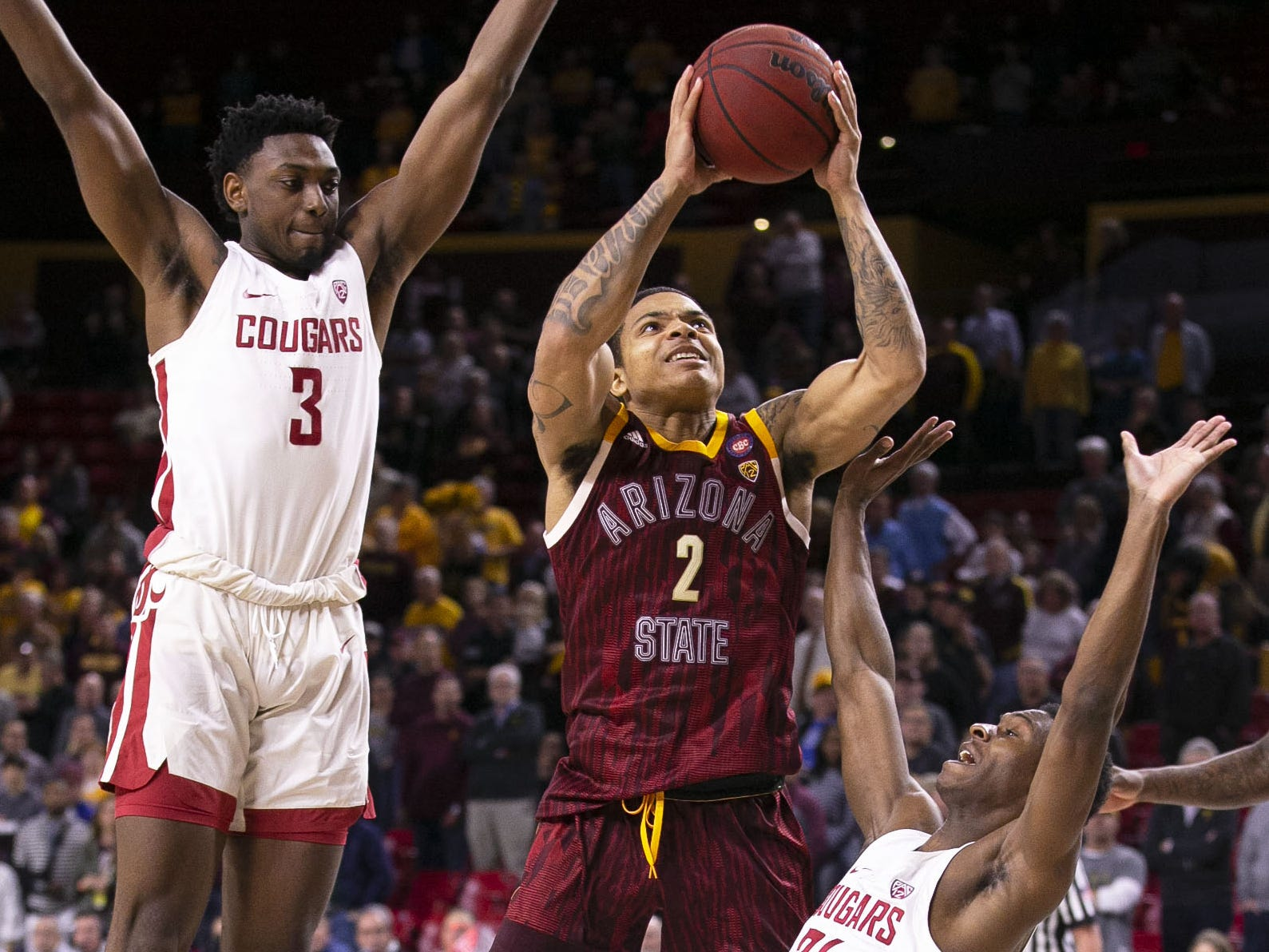 Arizona State Sun Devils guard Rob Edwards (2) is pressured by Washington State Cougars guard Viont'e Daniels (24) in the first half on Feb. 7 at Wells Fargo Arena in Tempe.