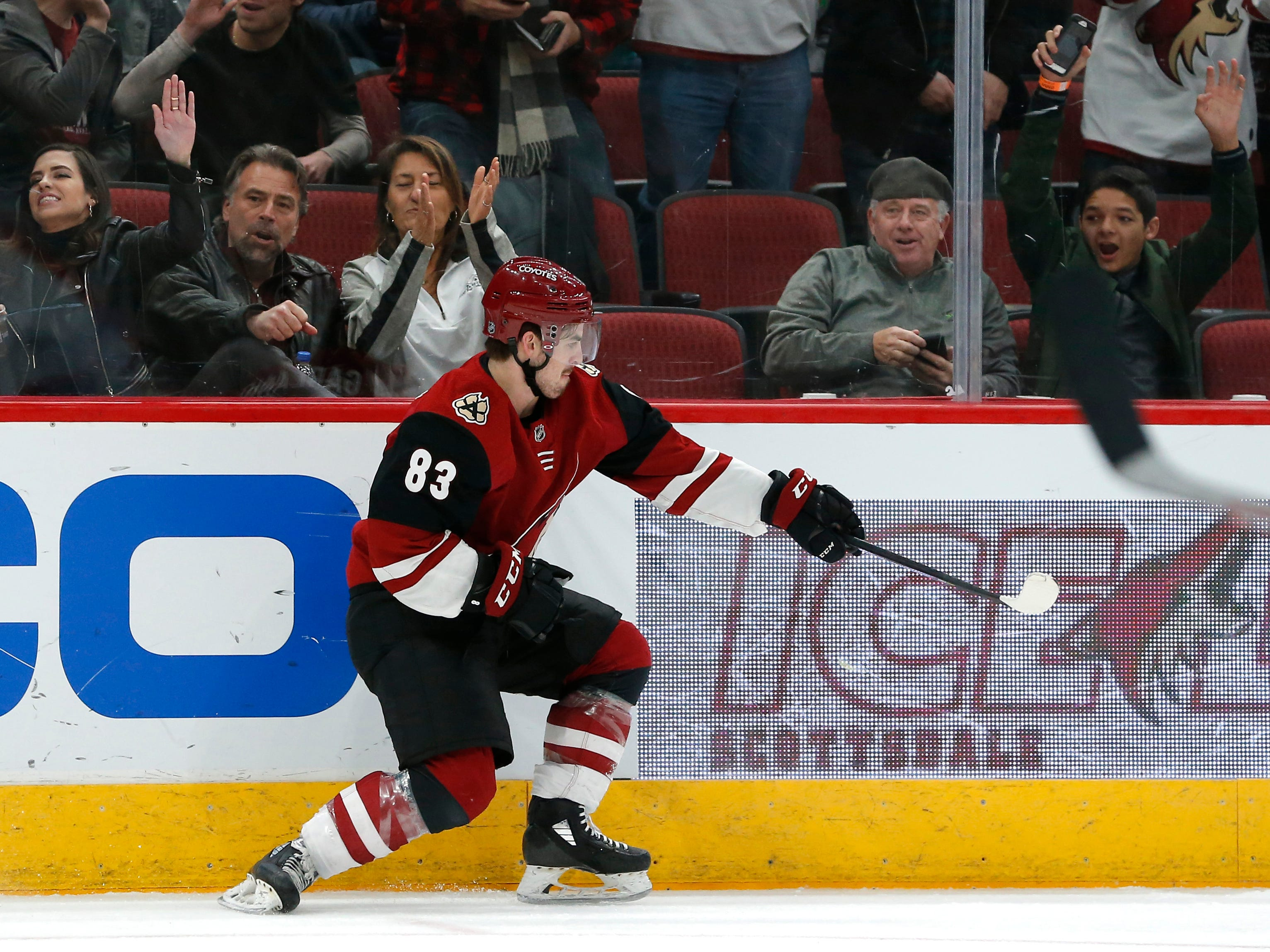 Arizona Coyotes right wing Conor Garland (83) celebrates after scoring a goal in the second period during an NHL hockey game against the Columbus Blue Jackets, Thursday, Feb. 7, 2019, in Glendale, Ariz.