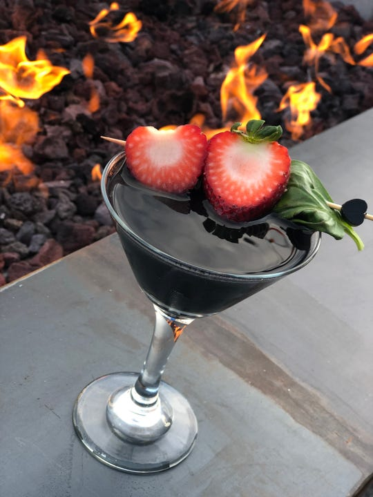 The Black Heart Social Club martini ($8) has Roku Japanese gin, basil, strawberry and grapefruit at Hula's Modern Tiki Anti-Valentine's Day party.