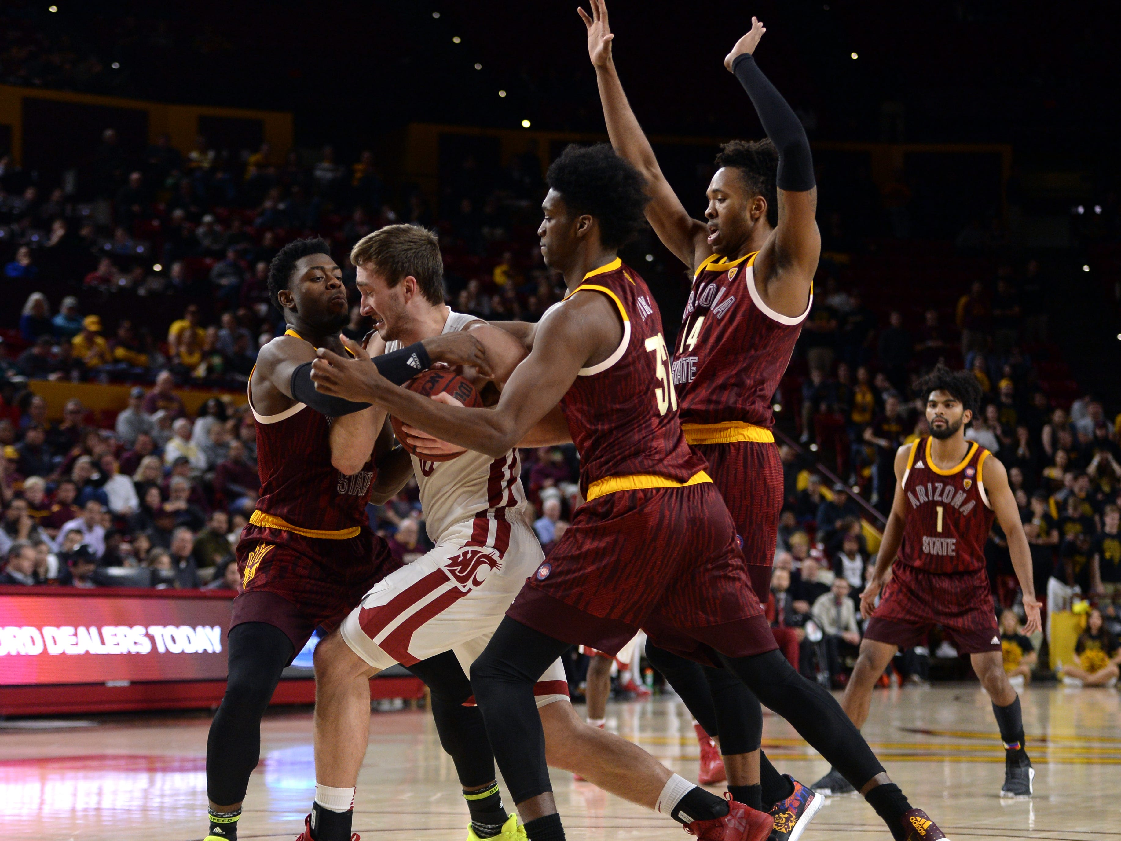 Feb 7, 2019; Tempe, AZ, USA; Washington State Cougars forward Jeff Pollard (13) protects the ball from Arizona State Sun Devils defenders during the second half at Wells Fargo Arena (AZ).