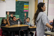 Third grade students raise their hands in Erica Kurz's class on Thursday, Feb. 7, 2019, at Longfellow Elementary in Mesa, Ariz. A new bill going through the legislature would change how much mandated instruction time ELL students receive, and would curb unintended consequences like segregated recess and lunch periods.
