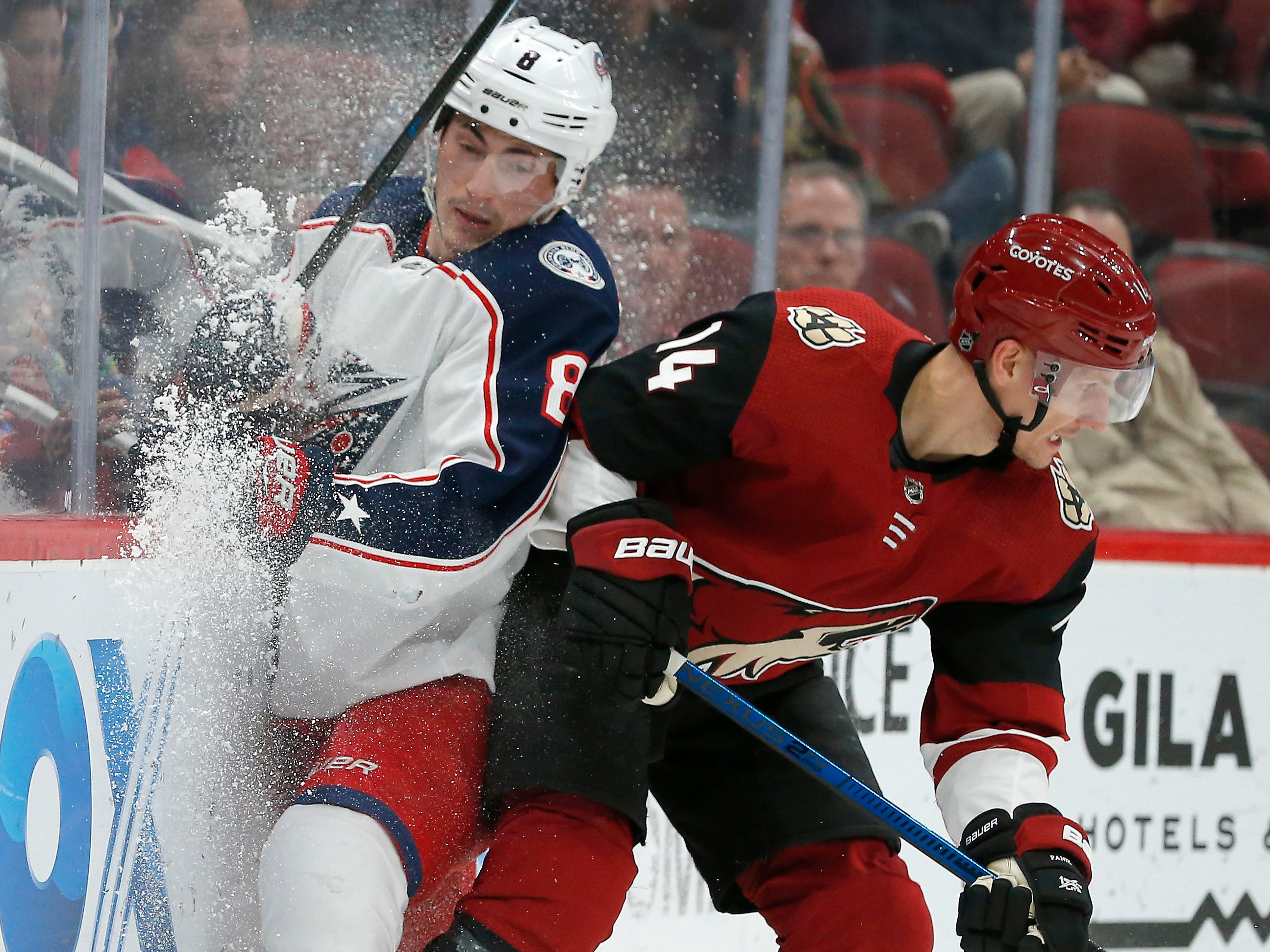 Arizona Coyotes right wing Richard Panik (14) checks Columbus Blue Jackets defenseman Zach Werenski away from the puck in the second period during an NHL hockey game, Thursday, Feb. 7, 2019, in Glendale, Ariz.