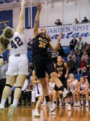 Elco's Amanda Smith goes up for two of her game-high 18 points against the defense of Ephrata's Madeline Groff.